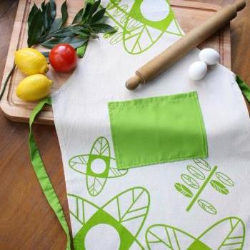 Cook APRON - Natural cotton canvas apron handprinted with flowers and leaves design.